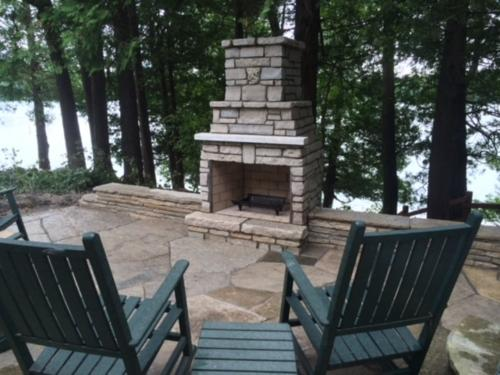 Outdoor fireplace with chairs (1)
