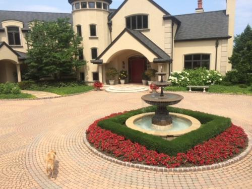 paver driveway with fountain